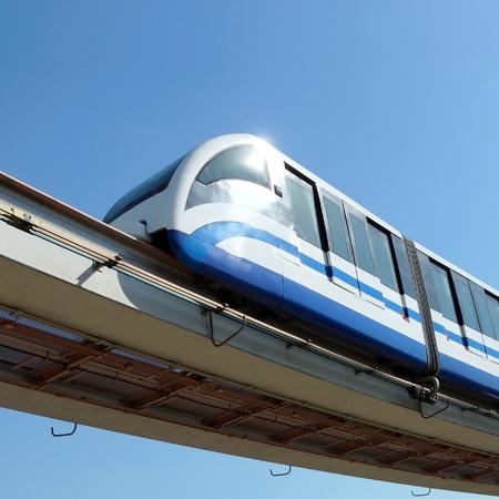 monorail train against the dark blue sky photo
