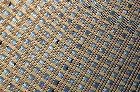 windows of a multystoried hotel building photo
