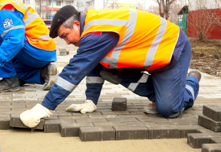 pave: 12_04_2012 Moscow, Russia. Workers stack a paving slabs on city streets.
