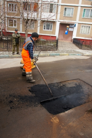 asphalt paving: 12_04_2012 Moscow, Russia. Road workers repair an asphalt covering after a winter season. Editorial