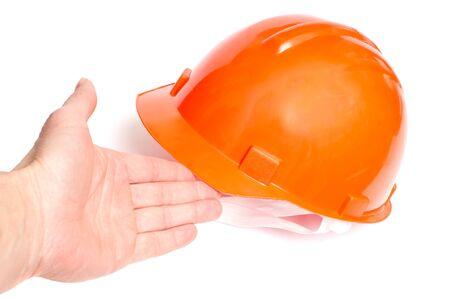 Building protective helmet on white background photo