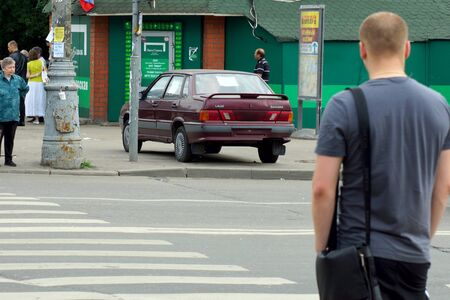 15 06 2012 Moscow  The person on road transition and incorrectly parked car  Stock Photo - 24244954