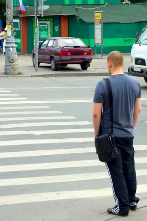 15 06 2012 Moscow  The person on road transition and incorrectly parked car  Stock Photo - 24244955
