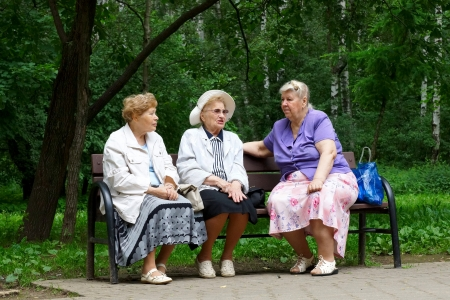 15 06 2012 Moscow, forest park. Three pensioners talk on a bench. Stock Photo - 14802963