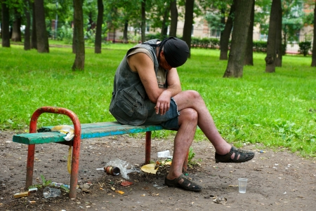 16 06 2012 Moscow  The drunk man sits on a shop in city park  Stock Photo - 24244956