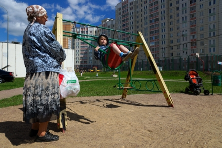 18 06 2012 Moscow  The girl shakes on a swing at a new playground  Stock Photo - 24244960