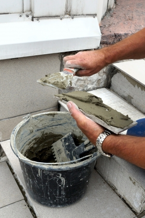 tile adhesive: Real photo of a tile laying