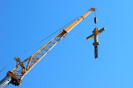 installation of an orthodox Christian cross photo