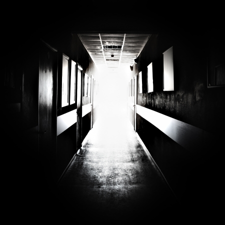 escape: Black corridor with bright light in the end