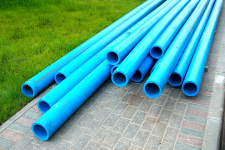 Harmless polyethylene water pipes on a green grass photo