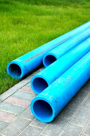 harmless: Harmless polyethylene water pipes on a green grass Stock Photo