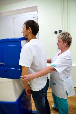 x ray equipment: 20120719 Russia. Moscow. The patient during passing of fluorographic inspection in one of city hospitals.