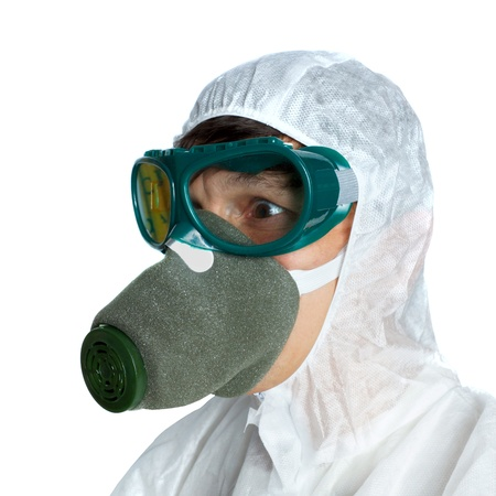 the man in protective overalls and a respirator photo