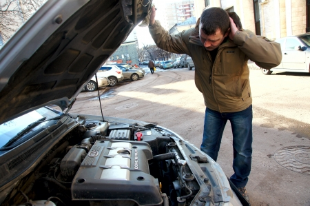 15.11.2012 Moscow. The driver examines the drive of the broken car. Stock Photo - 16377331