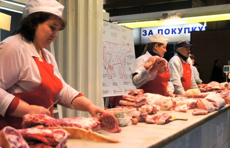 killings: 07.04.2012 Moscow. Cutting of a meat carcass in the grocery market. Editorial
