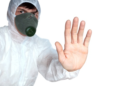 the man in protective overalls and respirator  shows a sign danger Stock Photo - 16496182