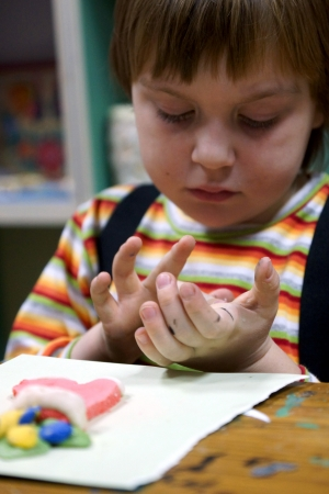 clay modeling: 07.12.2012 Moscow. Occupations in the creativity house, the Child molds from plasticine Editorial