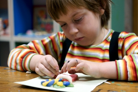 07.12.2012 Moscow. Occupations in the creativity house, the Child molds from plasticine
