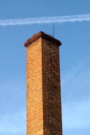 Brick pipe against a blue sky. photo