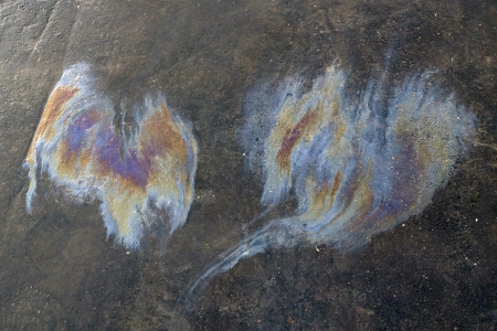 petrol stains on asphalt photo