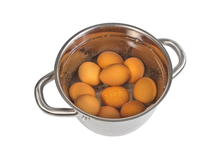 pan with cooking eggs, isolated on the white photo