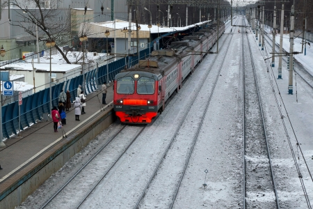 black train: 15.01.2013 Mytischi, Russia. Suburban electric train at railway station.