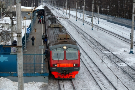15.01.2013 Mytischi, Russia. Suburban electric train at railway station.