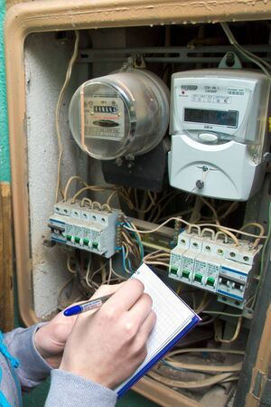 21 01 2013 Moscow. Write down indications of the multitariff electric meter. Stock Photo - 18368477
