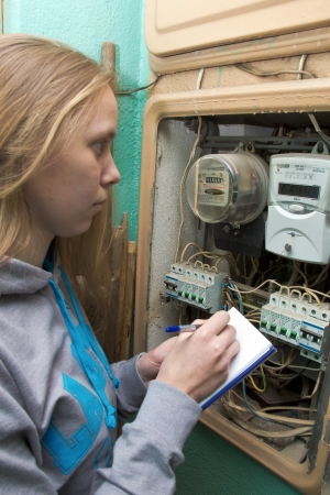 21 01 2013 Moscow. Write down indications of the multitariff electric meter. Stock Photo - 18368479