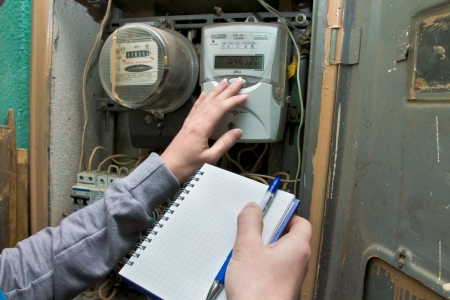21 01 2013 Moscow. Write down indications of the multitariff electric meter.