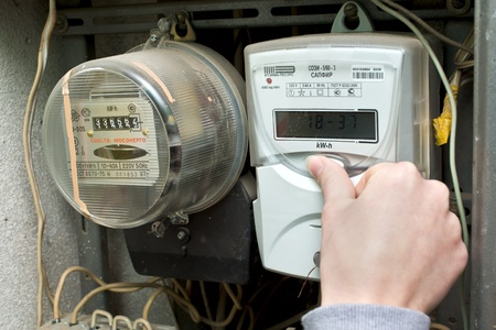 21 01 2013 Moscow. Write down indications of the multitariff electric meter. Stock Photo - 18368476