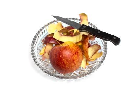 apple and a knife on a crystal plate Stock Photo - 17651616