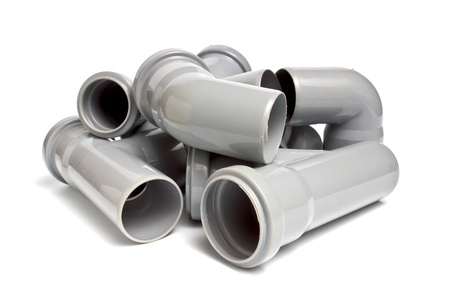 plumbing supply: composition from plastic sewer pipes, isolated on the white