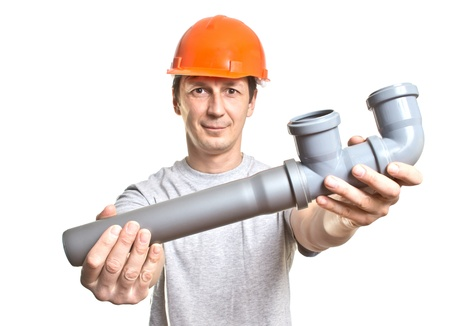 the young working plumber with the tool photo