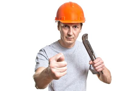 fittings: the young working plumber with the tool