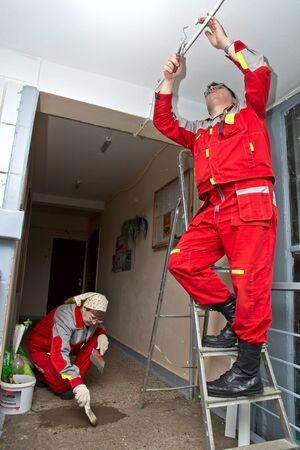 February 15, 2013, Moscow. Workers make repairs to the porch of a house. Stock Photo - 18112456