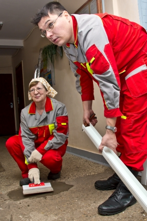February 15, 2013, Moscow. Workers make repairs to the porch of a house. Stock Photo - 18112450