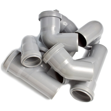 composition from plastic sewer pipes, isolated on the white Stock Photo - 18624885