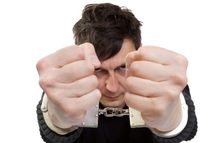 manacles: The man in handcuffs shakes fists  Stock Photo