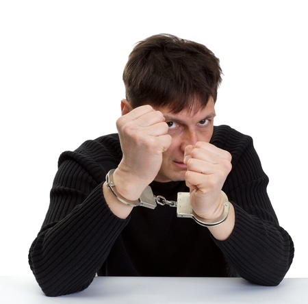 The man in handcuffs shakes fists Stock Photo - 18666448