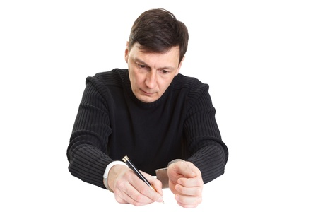The man in handcuffs writes something a ball pen. Stock Photo - 19203517