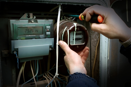 The electrician changes the old electric meter for the new Stock Photo - 20071153