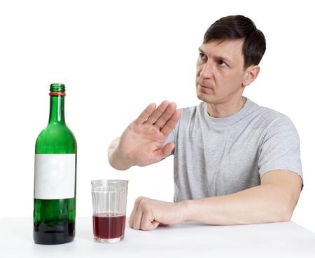 drinking wine ,man shows gesture of refusal photo