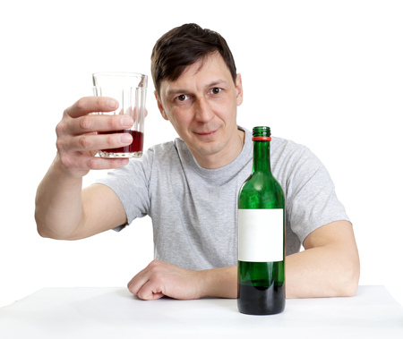 the man drinks red wine photo