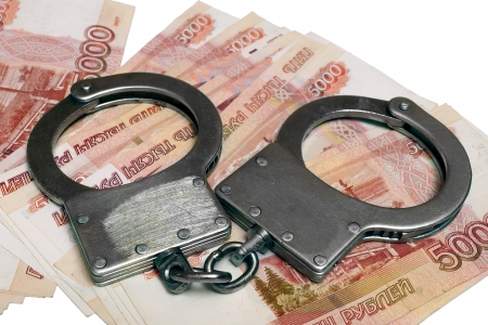 Banknotes and metal handcuffs Stock Photo - 24259460