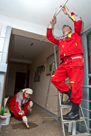 Moscow, Russia - FEBRUARY 18, 2013   Workers carry out renovation at a house entrance  Stock Photo - 24618067
