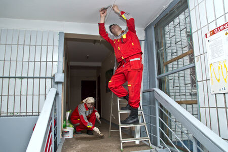 Moscow, Russia - FEBRUARY 18, 2013   Workers carry out renovation at a house entrance  Stock Photo - 24618068