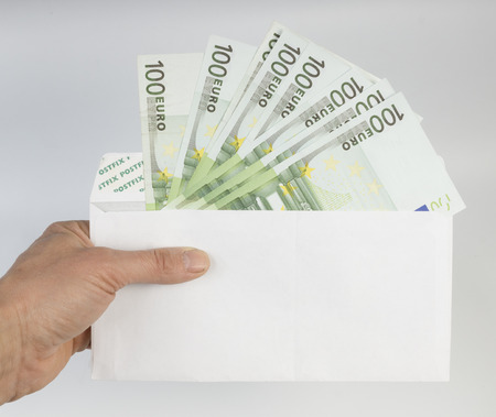euro the note in a hand on a white background photo