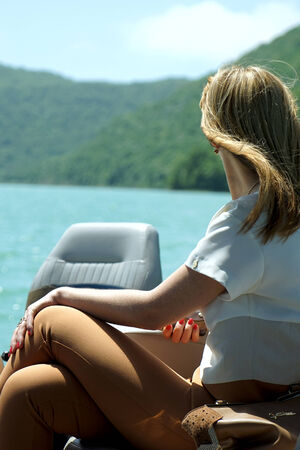 admires: the girl on the boat admires a landscape