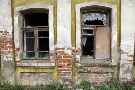 broken house: the broken windows of the old house Stock Photo